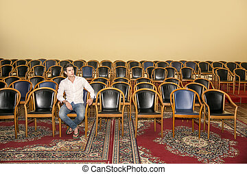Handsome Man Sitting at the Audience Chair Alone - Handsome...