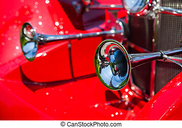 Old horns at an antique vintage red car - Old...