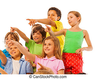 Large group of kids boys and girls pointing finger front...