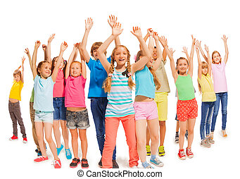 Many happy kids together raise hands up in the air - Large...