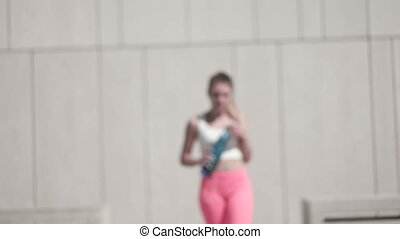 Fitness Woman Walking With Bottle - Woman in fitness attire...