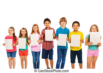Many kids stand with blank paper sheets in line