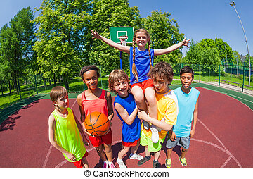 Girl on shoulders of her team after basketball - Girl with...