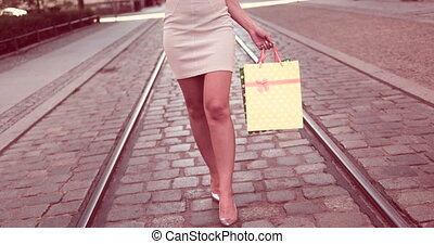 Young Woman Holding Bags - Video of a happy young woman...