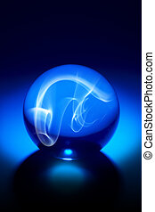 Crystal Ball - Dramaticly shot crystal ball with smokey...