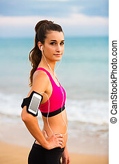 Young Fitness Woman with Smartphone - Young Fitness Woman...