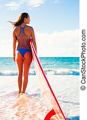 Surfer Girl - Beautiful Surfer Girl on the Beach at Sunset....