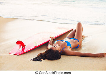 Beautiful Surfer Girl Relaxing on the Beach. Summer Outdoor...