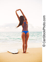 Beautiful Surfer Girl Stretching on the Beach. Summer...