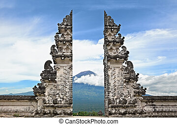 Symbol Bali - hindu temple on Agung mount background -...