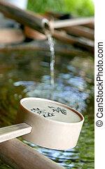 Water flowing from bamboo in zen garden