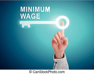 male hand pressing minimum wage key button over blue...