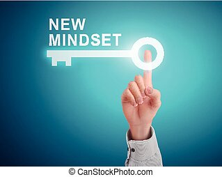 male hand pressing new mindset key