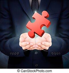 businessman holding jigsaw puzzle piece
