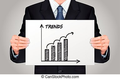 businessman holding trends growth graph - close-up look at...