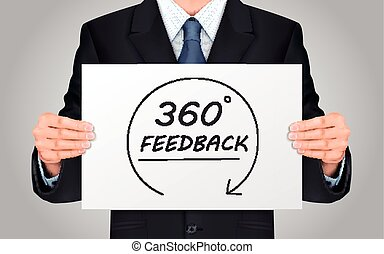 businessman holding 360 feedback content poster - close-up...