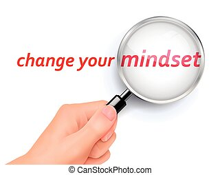change your mindset showing through magnifying glass held by...