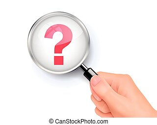questionnaire symbol showing through magnifying glass held...