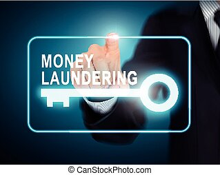 male hand pressing money laundering key button over blue...