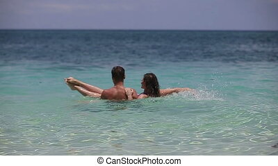 Happy couple in sea water