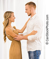 Family relations - Beautiful couple dancing at home and...