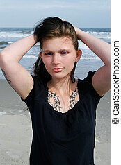 A beach portrait of a tattoo girl with piercings