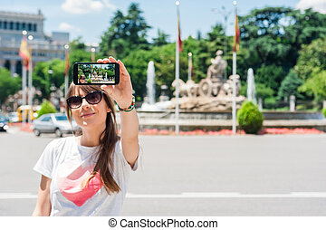 Woman taking pictures - Young tourist woman taking picture...