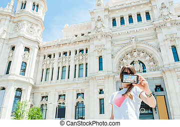 woman taking picture - Young tourist woman taking picture in...