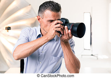 Photographer making photo on camera - Handsome photographer...