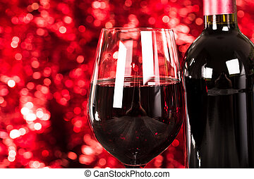 Close up on Glass of Red Wine with Lights Background