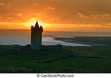 sunset capture of a old irish castle on west coast of...