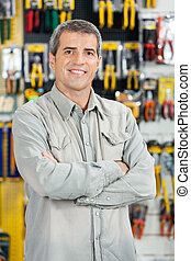 Happy Man Standing Arms Crossed In Hardware Store - Portrait...