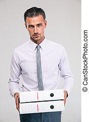 Confident businessman holding folders - Portrait of a...