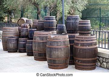 old wine barrels on a platform