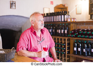 Right or wrong, I like it here - Senior man tasting wine,...