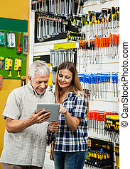Family Using Tablet Computer In Hardware Store