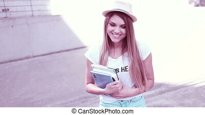 Happy Female Student Holding Books