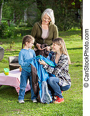 Family Assembling Tent At Campsite