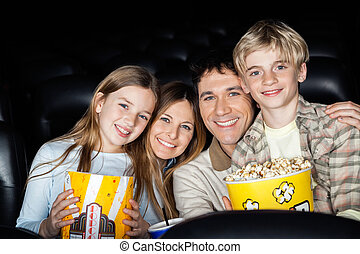 Happy Family With Popcorn At Cinema Theater - Portrait of...