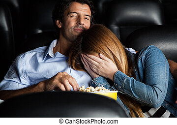 Frightened Woman Leaning On Man In Cinema Theater