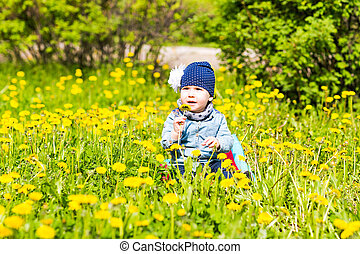 Happy little girl  on the meadow