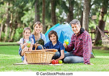 Family Having Good Time In Park