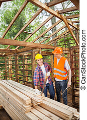 Construction Worker Standing In Wooden Cabin - Male...