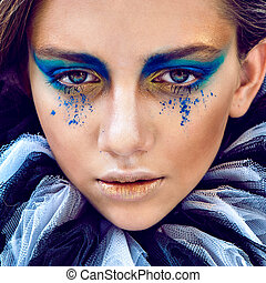 Woman with bright art make up. Close-up potrait - Woman with...