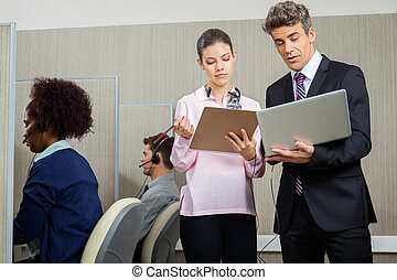 Business People Discussing In Call Center - Business people...