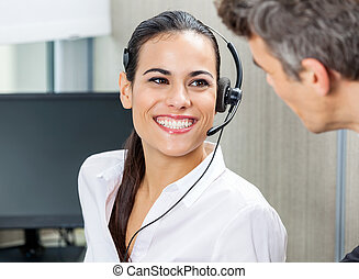 Happy Customer Service Representative Looking At Manager -...