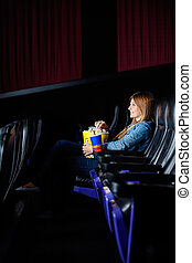 Woman Watching Film At Movie Theater