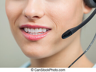Closeup Of Smiling Customer Service Representative With Headset