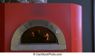 Cooking pizza in stove - Slow motion of placing pizza in...