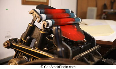 distributing ink on letterpress rollers - allowing ink on...
